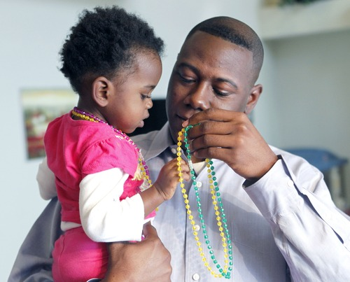 Al Hartmann  |  The Salt Lake Tribune Terry Achane and his nearly 2-year-old daughter, Teleah, Friday.  Achane was united with his daughter, placed for adoption at birth without his knowledge or consent, on Thursday. A 4th District Court judge made it official during a hearing Friday in Provo.