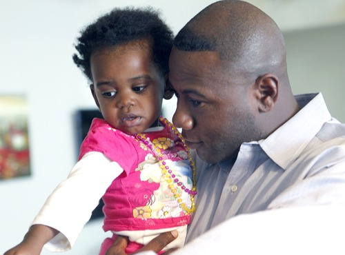 Al Hartmann  |  The Salt Lake Tribune Terry Achane with nearly 2-year-old daughter, Teleah, Friday.  Achane said support of others made it easier to keep fighting for his daughter, who was placed for adoption at birth without his knowledge or consent.