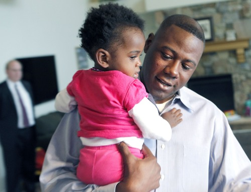 Al Hartmann  |  The Salt Lake Tribune Terry Achane and his nearly 2-year-old daughter, Teleah, Friday.  Achane was united with his daughter, placed for adoption at birth without his knowledge or consent, on Thursday. A 4th District Court judge made it official during Friday's hearing.