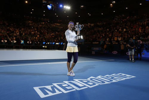 Victoria Azarenka of Belarus holds her trophy after winning the women's final against China's Li Na at the Australian Open tennis championship in Melbourne, Australia, Saturday, Jan. 26, 2013. (AP Photo/Andy Wong)