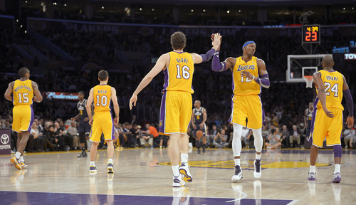 Los Angeles Lakers forward Pau Gasol (16), of Spain, celebrates with center Dwight Howard as forward Metta World Peace, left, guard Steve Nash, second from left, and guard Kobe Bryant head down the court during the first half of an NBA basketball game against the Utah Jazz, Friday, Jan. 25, 2013, in Los Angeles. (AP Photo/Mark J. Terrill)