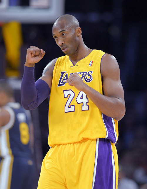 Los Angeles Lakers guard Kobe Bryant reacts as a timeout is called during the first half of the Lakers' NBA basketball game against the Utah Jazz, Friday, Jan. 25, 2013, in Los Angeles.  (AP Photo/Mark J. Terrill)