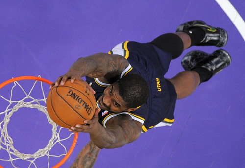 Utah Jazz forward Marvin Williams dunks during the first half of the Jazz's NBA basketball game against the Los Angeles Lakers, Friday, Jan. 25, 2013, in Los Angeles.  (AP Photo/Mark J. Terrill)