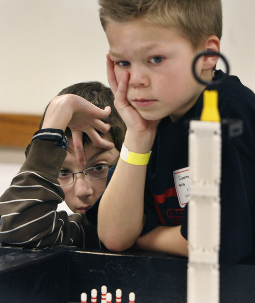 Scott Sommerdorf   |  The Salt Lake Tribune Isaac Murdock, left, and Cameron Neeley concentrate as their Butler Lego Team robot practices navigating through a series of tasks prior to competing in the 3rd annual Utah First Lego League Championships at the University of Utah, Saturday, January 26, 2013.