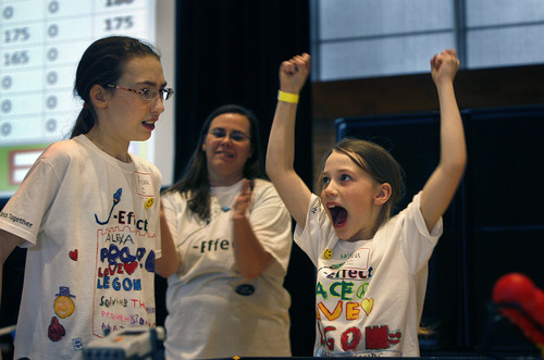 Scott Sommerdorf   |  The Salt Lake Tribune Angela Jentzsch, 8, right, celebrates as her team, J-Effect, completes a mission at the 3rd annual Utah First Lego League Championships at the University of Utah, Saturday, January 26, 2013. Her sister Alexa, 10, is at left.