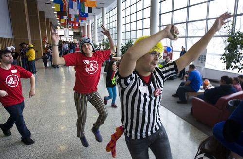 Scott Sommerdorf   |  The Salt Lake Tribune Nick Traeden, center, and Roger Backman, right, and other officials dance off to a lunch break after helping to referee and announce the first rounds of the 3rd annual Utah First Lego League Championships at the University of Utah, Saturday, January 26, 2013.