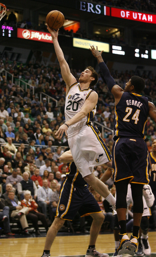 Rick Egan  | The Salt Lake Tribune   Utah Jazz shooting guard Gordon Hayward (20) goes in for two points as Indiana Pacers small forward Paul George (24) defends, in NBA action,  Jazz vs. Indiana game, Saturday, January 26, 2013.