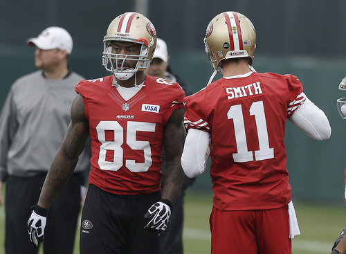 San Francisco 49ers tight end Vernon Davis (85) and quarterback Alex Smith (11) practice at the team's NFL football training facility in Santa Clara, Calif., Wednesday, Jan. 23, 2013. The 49ers are scheduled to play the Baltimore Ravens in Super Bowl XLVII on Sunday, Feb. 3 in New Orleans. (AP Photo/Jeff Chiu)