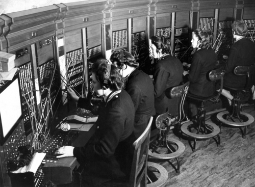 FILE -This March 20, 1944, file photo shows switchboard operators in London. An Associated Press investigation released in January 2013 found that millions of mid-skill, mid-pay jobs have disappeared over the past five years and have been replaced with technology. Peter Lindert, an economist at the University of California-Davis, does not believe workers are doomed to unemployment. With the right skills and education, Lindert, says, workers can learn to work with the machines. (AP Photo/File)