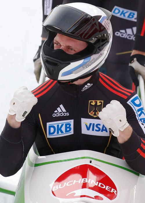 Francesco Friedrich from Germany celebrates after winning the 2-man Bobsled World Championship competition in St. Moritz, Switzerland, Sunday, Jan. 27, 2013. (AP Photo/Keystone/Arno Balzarini)