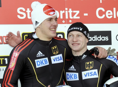 Gold medalists Francesco Friedrich, right, and  brakeman Jannis Baecker, left, from Germany, celebrate after the 2-man Bobsled World Championship competition in St. Moritz, Switzerland, Sunday Jan. 27, 2013. (AP Photo/Keystone/Karl Mathis)