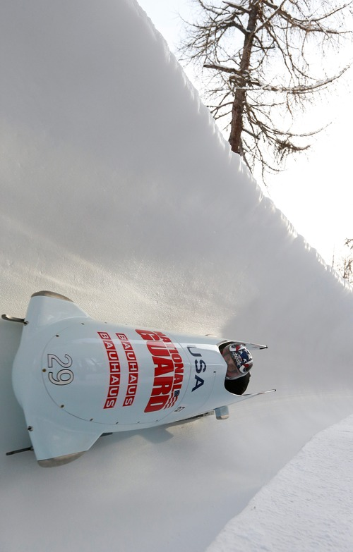 Nick Cunningham and Dallas Robinson from the USA speed down  the track during the third run of the 2-man bobsled  competition at the Bobsled World Championships in St. Moritz, Switzerland, Sunday, Jan. 27, 2013. (AP Photo/Keystone/Arno Balzarini)