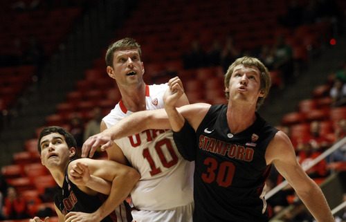 Ashley Detrick  |  The Salt Lake Tribune Stanford Cardinal guard Christian Sanders (1), Utah Utes forward Renan Lenz (10) and Stanford Cardinal Grant Verhoeven (30) fight for position to rebound a free throw  during the game against Stanford at Utah Sunday January 27, 2013. Stanford won, 87-56.