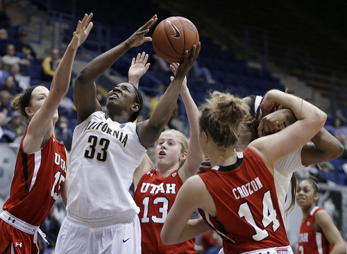 California's Talia Caldwell (33) shoots against Utah's Michelle Plouffe, left, Rachel Messer (13) and Paige Crozon (14) in the second half of an NCAA college basketball game Sunday, Jan. 27, 2013, in Berkeley, Calif. (AP Photo/Ben Margot)