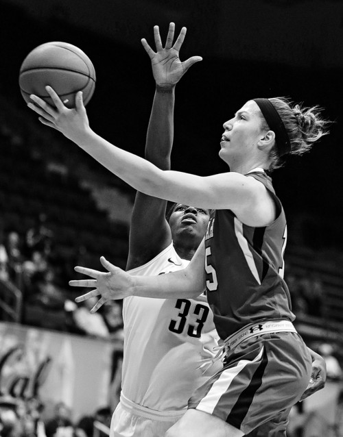 Utah's Michelle Plouffe, right, lays up a shot against California's Talia Caldwell (33) in the first half of an NCAA college basketball game Sunday, Jan. 27, 2013, in Berkeley, Calif. (AP Photo/Ben Margot)