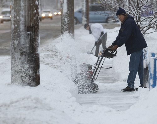 Al Hartmann  |  The Salt Lake Tribune People dig out by snowblower and shovel during Monday morning's difficult commute.
