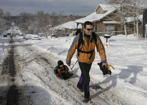 Kim Raff  |  The Salt Lake Tribune Chris Pasko pulls his son Jasper Pasko on a sled up the middle of Kensington Avenue the morning after a winter storm in Salt Lake City on Monday, January 28, 2013.