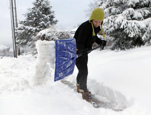 Al Hartmann  |  The Salt Lake Tribune Megan Kelly shovels her sidewalk along 2700 South in Salt Lake City on Monday morning, Jan. 28 after a winter storm that started Sunday.