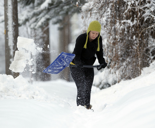 Al Hartmann  |  The Salt Lake Tribune Megan Kelly shovels out her sidewalk along 2700 South in Sugarhouse Monday morning January 28 after yesterday's storm.