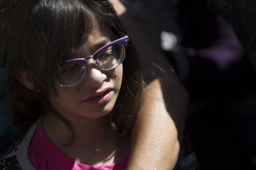 A girl cries during the burial of her brother, soldier Leonardo Machado, at a cemetery in Santa Maria, Brazil, Monday, Jan. 28, 2013. A fast-moving fire roared through the crowded, windowless Kiss nightclub in this southern Brazilian city early Sunday, killing more than 230 people. Many of the victims were under 20 years old, including some minors. (AP Photo/Felipe Dana)