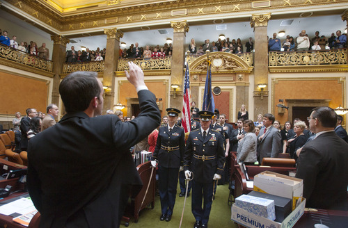 Steve Griffin | The Salt Lake Tribune   The Utah National Guard Color Guard holds the state and American Flags during the singing of the National Anthem during the opening of the 2013 legislative season in the House chambers at the Utah State Capitol in Salt Lake City Monday January 28, 2013.