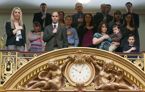 Steve Griffin | The Salt Lake Tribune   Spectators in the gallery sing the National Anthem during the opening of the 2013 legislative session in the House chambers at the Utah State Capitol in Salt Lake City Monday January 28, 2013.