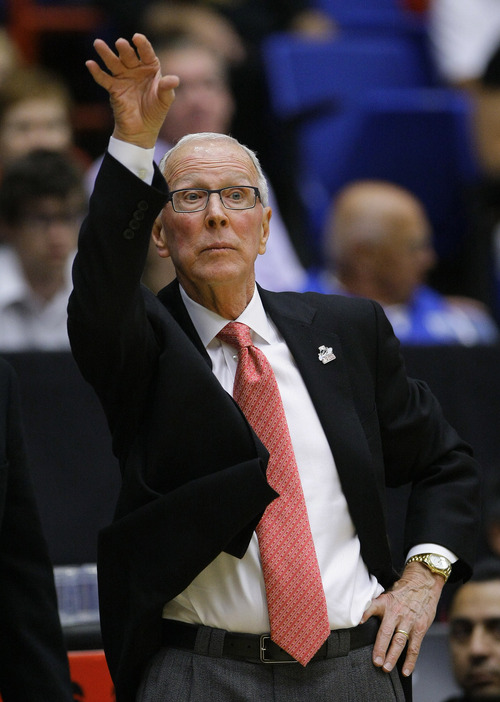 San Diego State head coach Steve Fisher signals his team as they go against Temple during a West Regional NCAA college basketball tournament third round game Saturday, March 19, 2011, in Tucson, Ariz.  (AP Photo/Matt York)