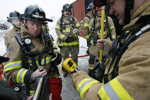 Francisco Kjolseth  |  The Salt Lake Tribune Members of the Salt Lake City Fire Department get ready to try out a new thermal imaging camera on a live fire drill. The cameras allow firefighters to see the different gradations of heat in a structure which can assist in finding victims or hot spots as they navigate smoke-filled environments.