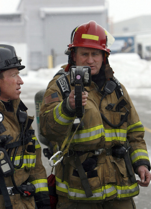 Francisco Kjolseth  |  The Salt Lake Tribune Capt. Dave Dixon of the Salt Lake City Fire Department overlooks a thermal imaging camera during a live training to test them out in action. The cameras allow firefighters to see the different gradations of heat in a structure which can assist in finding victims or hot spots as they navigate smoke-filled environments.