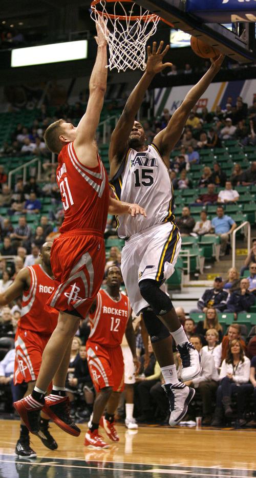 Rick Egan  | The Salt Lake Tribune   Utah Jazz power forward Derrick Favors (15) goes in for a dunk over Houston Rockets point guard Toney Douglas (15), in NBA action, Utah Jazz vs. the Houston Rockets, in Salt Lake City, Monday, January 28, 2013.