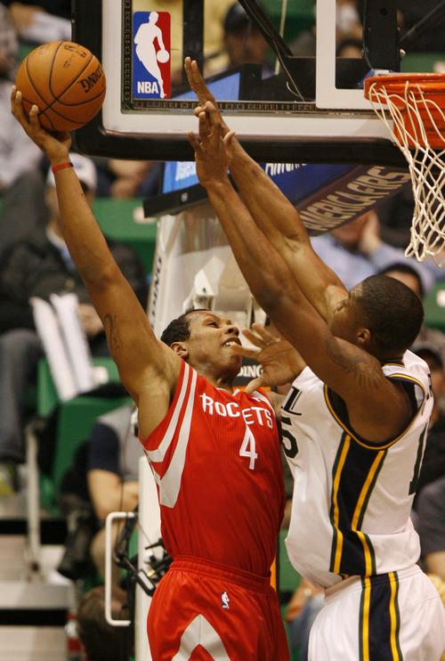Rick Egan  | The Salt Lake Tribune   Houston Rockets power forward Greg Smith (4) shoots over Utah Jazz power forward Derrick Favors (15), in NBA action, Utah Jazz vs. the Houston Rockets, in Salt Lake City, Monday, January 28, 2013.