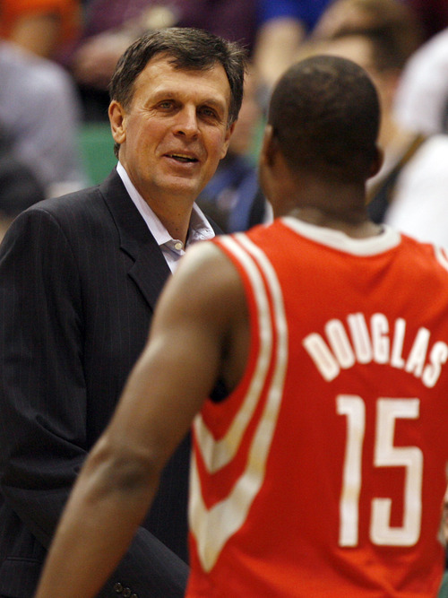 Rick Egan  | The Salt Lake Tribune   Houston Rockets head coach Kevin McHale is all smiles as point guard Toney Douglas (15) go to the bench and  the Rockets lead the Jazz by 40 points in the fourth quarter,  in NBA action, Utah Jazz vs. the Houston Rockets, in Salt Lake City, Monday, January 28, 2013.
