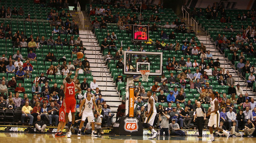 Rick Egan  | The Salt Lake Tribune   A sparse crowd remains to watch the final minutes, as the Jazz trail by nearly 50 points,  in NBA action, Utah Jazz vs. the Houston Rockets, in Salt Lake City, Monday, January 28, 2013.
