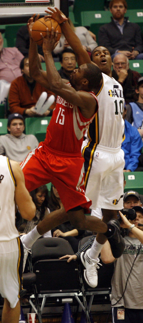 Rick Egan  | The Salt Lake Tribune   Utah Jazz point guard Alec Burks (10) gets his hand on the ball, as Houston Rockets point guard Toney Douglas (15) takes a shot, in NBA action, Utah Jazz vs. the Houston Rockets, in Salt Lake City, Monday, January 28, 2013.