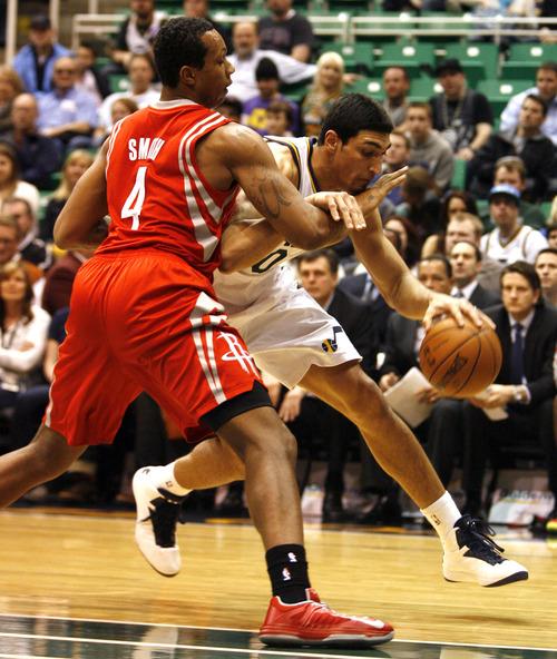 Rick Egan  | The Salt Lake Tribune   Utah Jazz center Enes Kanter (0) tries to get past, Houston Rockets power forward Greg Smith (4), in NBA action, Utah Jazz vs. the Houston Rockets, in Salt Lake City, Monday, January 28, 2013.