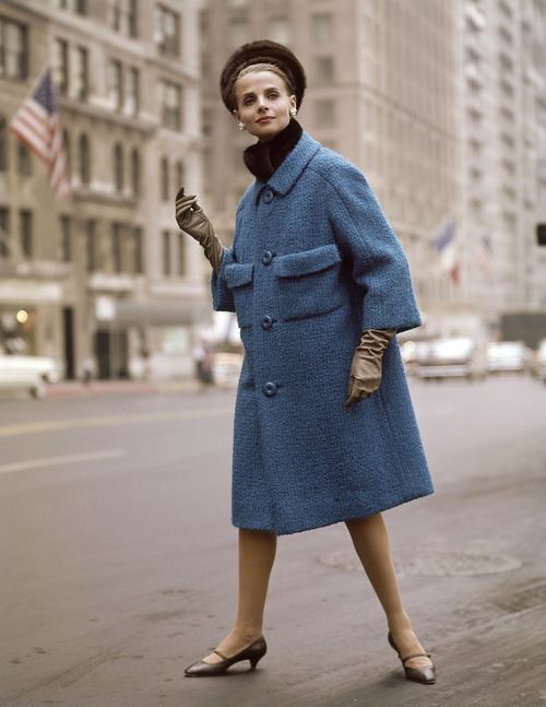 Blue coat with black hat, brown gloves and shoes fashion coat in 1963. (AP Photo)