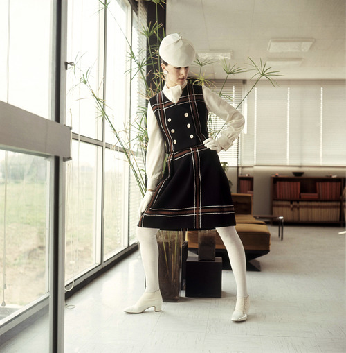 A black woolen brown checkered ensemble, consisting of a pleated skirt with matching waistcoat & A white Jersey Blouse, April 18, 1968. (AP Photo/Mario Torrisi)