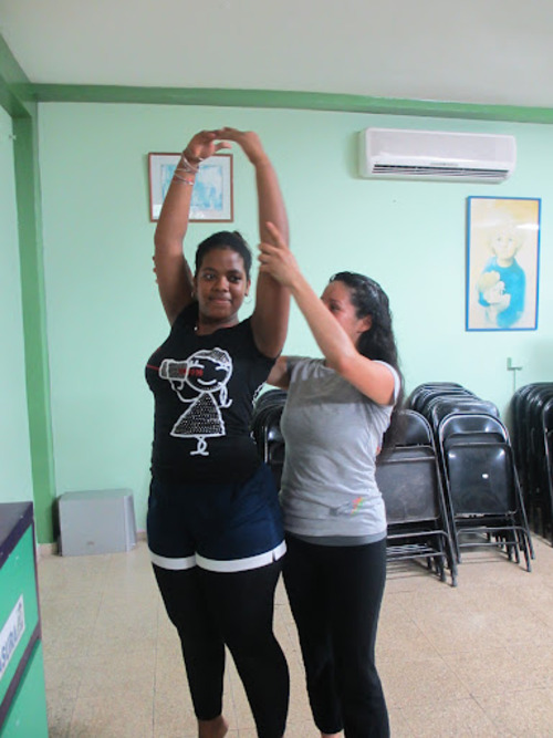 Courtesy image University of Utah senior Eiby Lobos working with one of the young ladies who live at the Malambo Orphanage in Panama City.