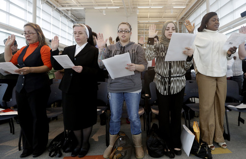Immigrants take the U.S. oath of citizenship during naturalization ceremony Monday, Jan. 28, 2013, in Irving, Texas.  Key Democratic and Republican senators are pledging to get a wide-ranging immigration bill through the Senate by summer even as they point to numerous pitfalls ahead. (AP Photo/LM Otero)