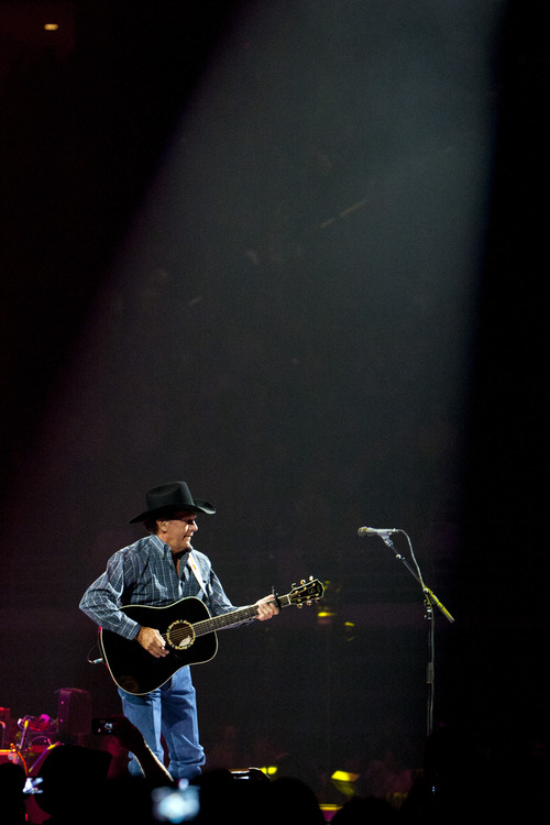 Chris Detrick  |  The Salt Lake Tribune George Strait performs at EnergySolutions Arena Friday January 25, 2013.