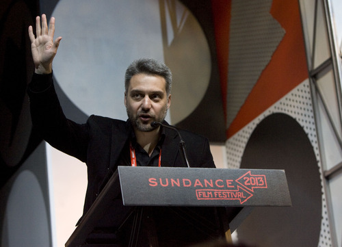 "Kim Raff  |  The Salt Lake Tribune Director Srdan Golubovic accepts the World Cinema Dramatic Special Jury Award for his film ""Circles"" during the Sundance Film Festival Awards Ceremony at Snyderville Basin Fieldhouse Recreation Center in Park City on January 26, 2013."