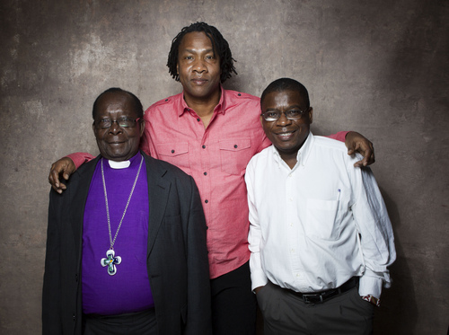 """From left, Bishop Christopher Senyonjo, filmmaker Roger Ross Williams and Rev. Kapya Kaoma from the film """"God Loves Uganda"""" pose for a portrait during the 2013 Sundance Film Festival on Sunday, Jan. 20, 2013 in Park City, Utah. (Photo by Victoria Will/Invision/AP Images)"""