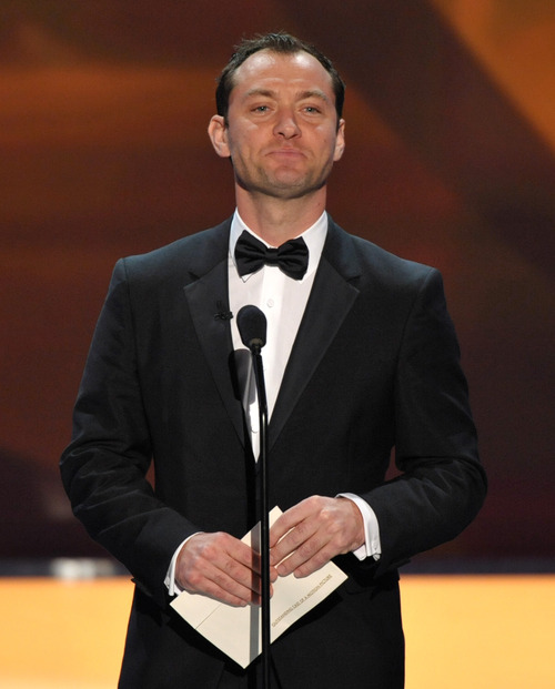 Jude Law presents the award for outstanding cast in a motion picture at the 19th Annual Screen Actors Guild Awards at the Shrine Auditorium in Los Angeles on Sunday Jan. 27, 2013. (Photo by John Shearer/Invision/AP)