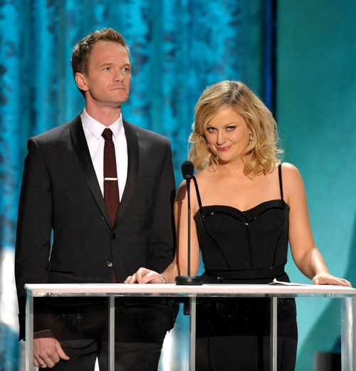 Amy Poehler, right, and Neil Patrick Harris present the award for outstanding male actor in a drama series at the 19th Annual Screen Actors Guild Awards at the Shrine Auditorium in Los Angeles on Sunday Jan. 27, 2013. (Photo by John Shearer/Invision/AP)