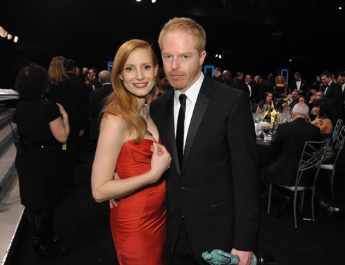Jessica Chastain, left, and Jesse Tyler Ferguson pose in the audience at the 19th Annual Screen Actors Guild Awards at the Shrine Auditorium in Los Angeles on Sunday Jan. 27, 2013. (Photo by John Shearer/Invision/AP)