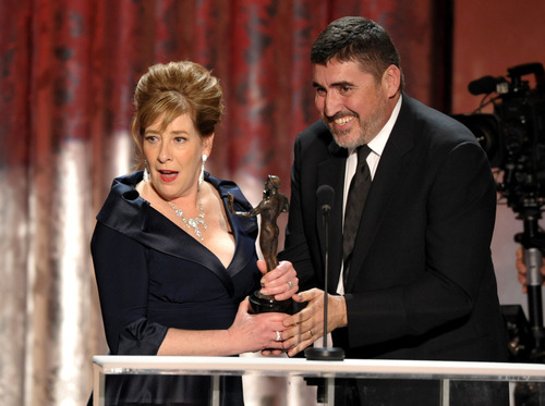 """Phyllis Logan, left, accepts the award from Alfred Molina for outstanding ensemble in a drama series for """"Downton Abbey"""" at the 19th Annual Screen Actors Guild Awards at the Shrine Auditorium in Los Angeles on Sunday Jan. 27, 2013. (Photo by John Shearer/Invision/AP)"""