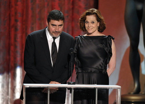 Alfred Molina, left, and Sigourney Weaver present the award for outstanding ensemble in a drama series at the 19th Annual Screen Actors Guild Awards at the Shrine Auditorium in Los Angeles on Sunday Jan. 27, 2013. (Photo by John Shearer/Invision/AP)