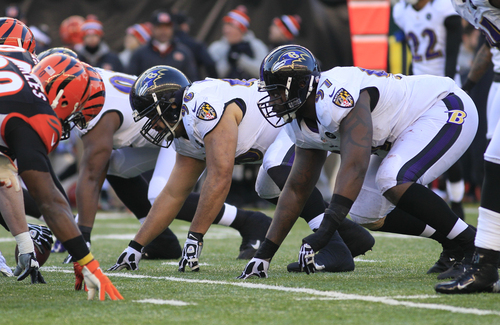 Baltimore Ravens nose tackle Ma'ake Kemoeatu (96) and defensive end Arthur Jones (97) line up against the Cincinnati Bengals in an NFL football game, Sunday, Dec. 30, 2012, in Cincinnati. (AP Photo/Tom Uhlman)