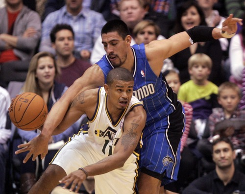 Kim Raff  |  The Salt Lake Tribune Utah Jazz point guard Earl Watson (11) steals the ball from Orlando Magic center Nikola Vucevic (9) during a game at EnergySolutions Arena in Salt Lake City on Dec. 5, 2012. Jazz went on to win 87-81.