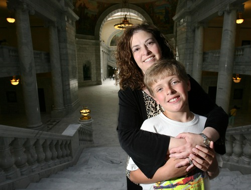 Steve Griffin  |  The Salt Lake Tribune  Allyson Gamble with her ten-year-old son Ben on Capitol HIll in Salt Lake City, Utah Monday, June 20, 2011. While Gamble was pregnant with her son she was suffering from a rare form of heart failure that researchers in Utah are now one step closer to understanding.